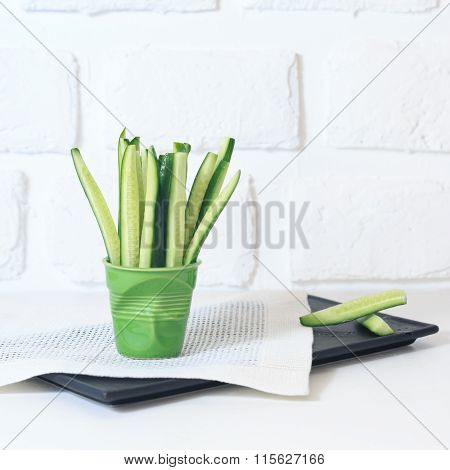 Cucumber Slices In A Green Glass