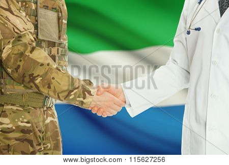Military Man In Uniform And Doctor Shaking Hands With National Flag On Background - Sierra Leone