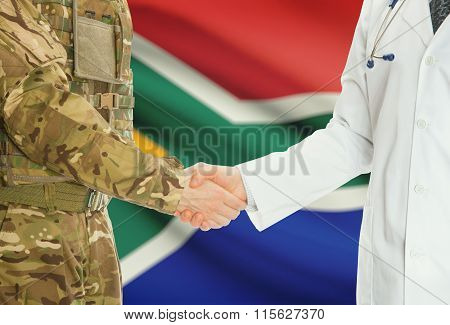Military Man In Uniform And Doctor Shaking Hands With National Flag On Background - South Africa