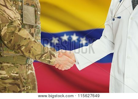 Military Man In Uniform And Doctor Shaking Hands With National Flag On Background - Venezuela