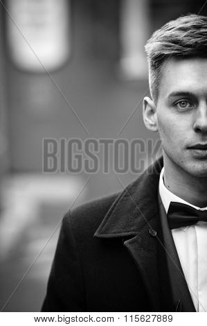 Handsome Innocent Blonde Groom With Blue Eyes In A Street Face Closeup B&w