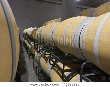 Indoor Photo Of Wooden Barrels In Old Winery