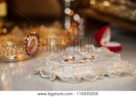 Elegant, Expensive Two Golden Wedding Rings With Pearls On Ornated White Heart Shaped Cushion And Ta
