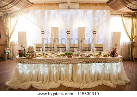 Romantic Fairytale Catered White Table At Wedding Reception With Lights