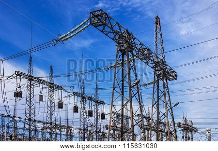 High-voltage Line With Electric Pylons On The Background Of Blue Sky