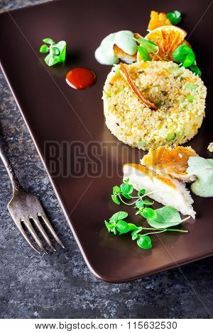 Salad With The Couscous And Tangerines On The Plate. .