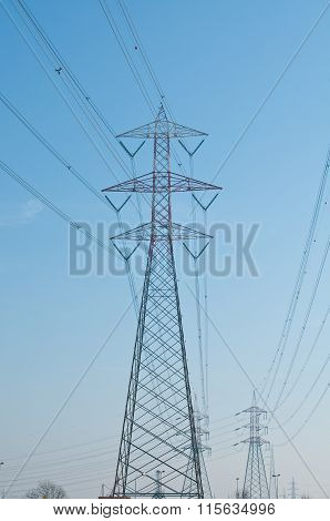 Pylons Of Steel That Are Used To Carry Electrical Current Silhouetted Against The Sky