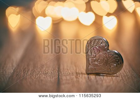 Garland lights on wooden rustic background. Valentine's day background with hearts. The concept of love and Valentine's day.