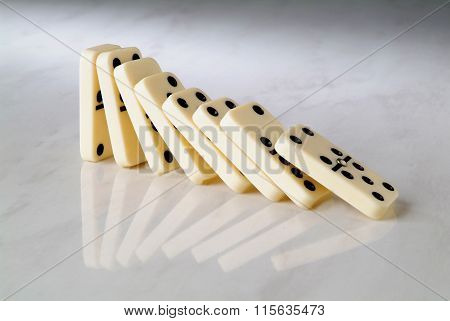 Group Dominoes Fall On A Neutral