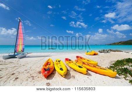 Beautiful tropical beach with palm trees, white sand, turquoise ocean water and blue sky at exotic island