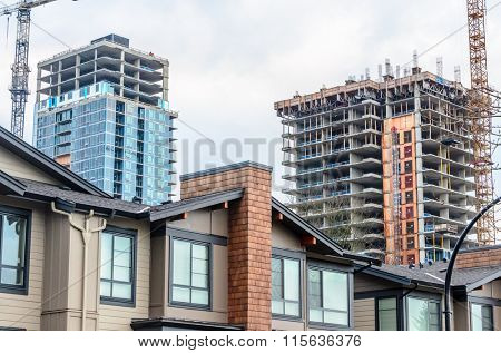 Home or Office building construction with new townhouses in front.