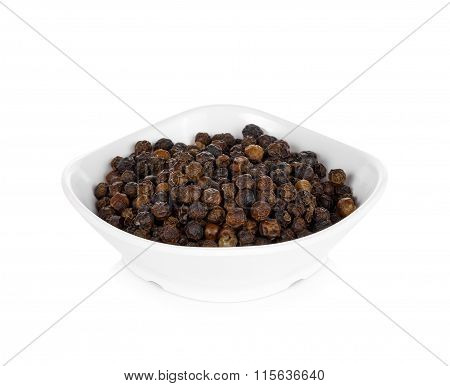 Pile Of Black Peppercorns On A Plate