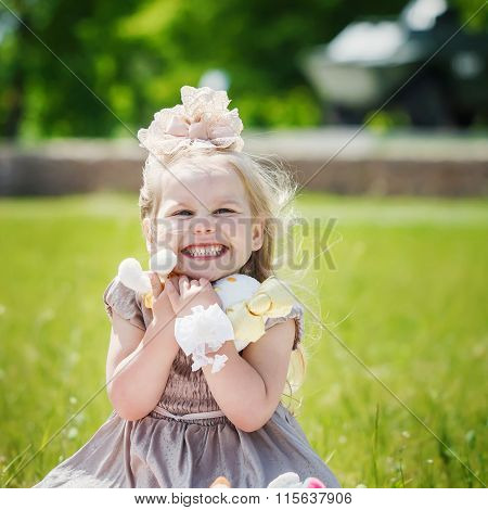 Portrait Of Smiling Girl Holding Her Favourite Soft Toy In Summe
