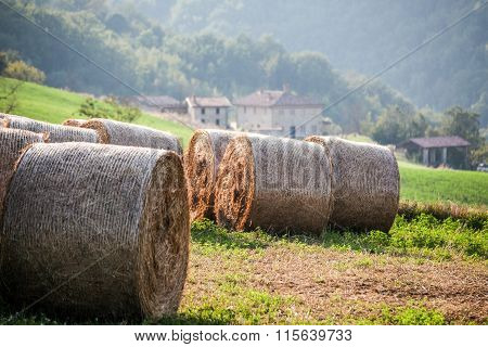 italian hill landscape with hay bales