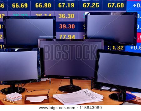 Business interior with  large group of pc monitor and  keyboard  in office.