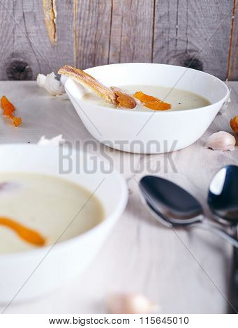 Garlic cream soup on white background