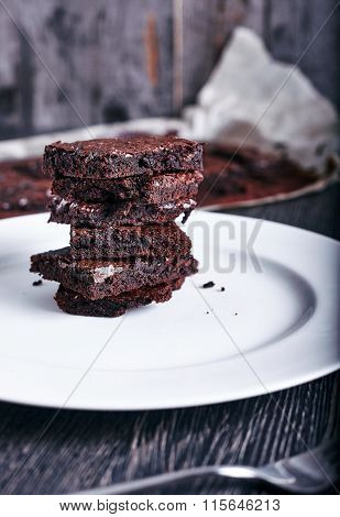 Cake chocolate brownies on white plate