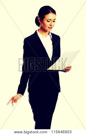 Businesswoman with paper notes