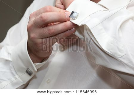 The Man Wears A Cufflink