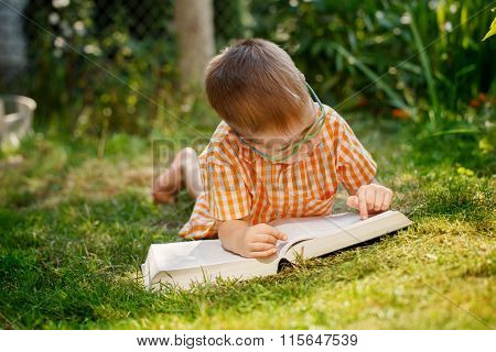 Portrait  Happy Little Boy Holding A Big Book  On His First Day To School Or Nursery. Outdoors, Back