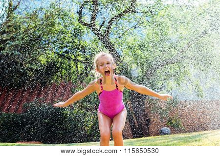 Little Girl Shouting Under Water Drops.