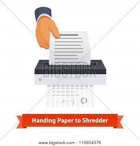 Man handing paper to shredder
