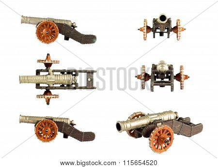 Cannon Toy On The White Background.multiple Perspectives Conceptual.