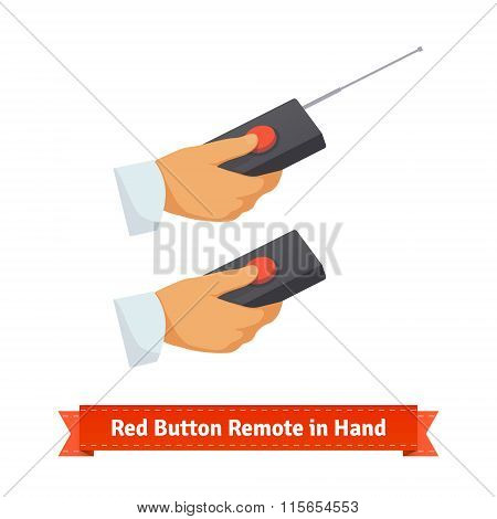 Red button remote control with antenna in hand