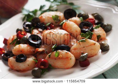 Gnocchi di patata, italian potato noodle with tomato sauce and olives