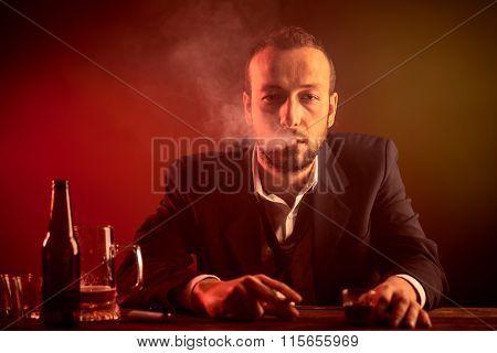 Drunk Businessman in a Bar
