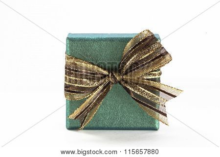 Green Gift Box With A Green Ribbon And Bow In White Isolated Background