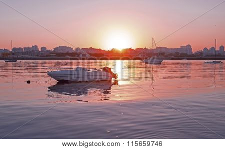 Yachts mooring in the harbor from Portimao in Portugal at sunset
