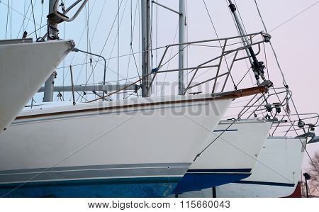 Perspective detailed view of white yachts