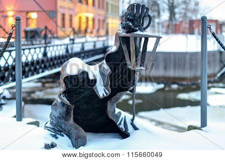 Black Ghost bronzed sculpture. Danes river quay.