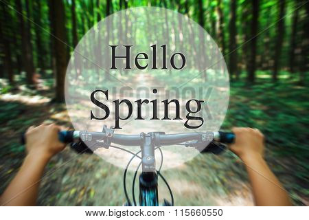 hello spring. a mountain bicycle descending quickly forest