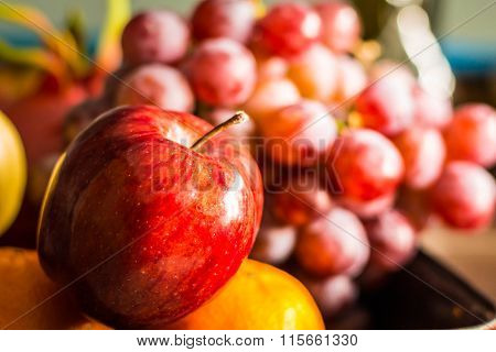 Red apple and other fruits at the market place. ** Note: Shallow depth of field