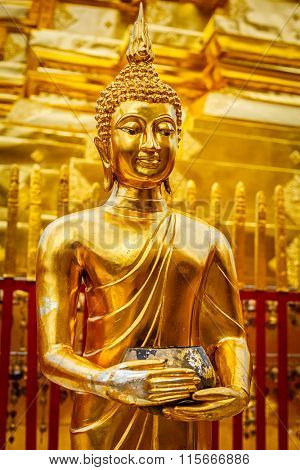 Gold Buddha statue in Wat Phra That Doi Suthep, Chiang Mai, Thailand