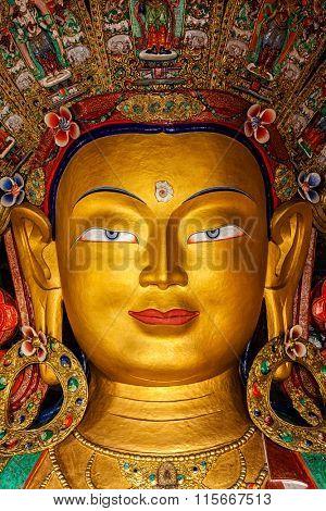 Maitreya Buddha statue face close up in Thiksey Gompa. Ladakh, India
