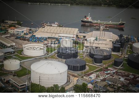 Industrial Oil Port Along The River.