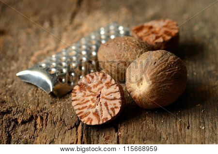 Nutmeg On Wooden Table
