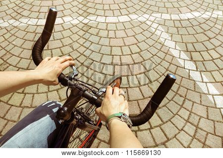 Woman Riding  Bicycle In Central City Square - Woman Hands On Modern Sport Bike