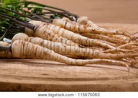 Parsley Roots On Wooden Cutting Board