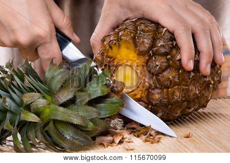 Process Of Cutting Pineapple On A Cutting Board