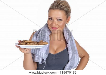 Sporty woman with a plate of cookies