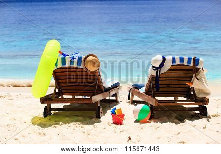Two chairs on the tropical sand beach