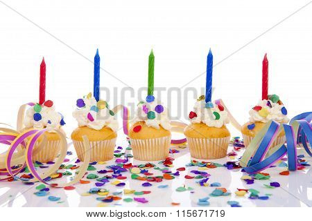 Birthday Cupcakes With Candle And Colorful Confetti