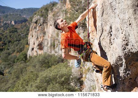 Sportsman climbing on the rock.
