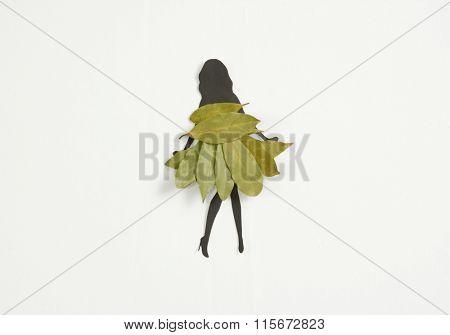 woman silhouette wearing a dress of laurel leaves