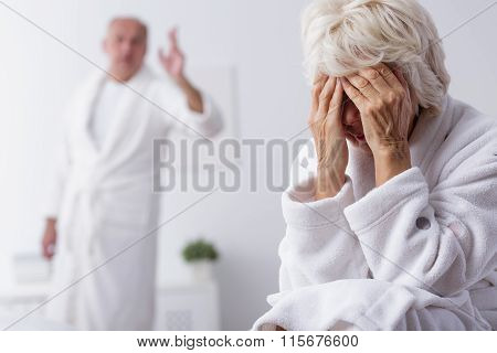 Elderly Couple Arguing In Bedroom