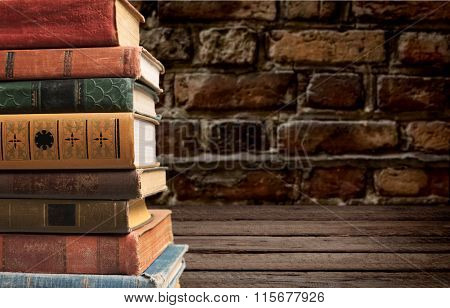Stacked old books.